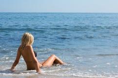 Girl among the ocean waves. Stock Photos