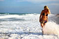 Girl in ocean waves Royalty Free Stock Photography
