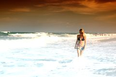Girl in ocean waves Royalty Free Stock Images