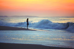 Girl and ocean waves Royalty Free Stock Photos