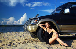Girl and off-road car Stock Image
