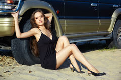 Girl and off-road car Royalty Free Stock Photo