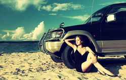 Girl and off-road car Royalty Free Stock Image