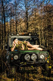 Girl and off-road vehicle Stock Photography