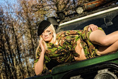 Girl and off-road vehicle Stock Photos