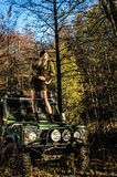 Girl and off-road vehicle Royalty Free Stock Photo