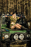 Girl and off-road vehicle Royalty Free Stock Photos