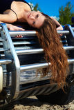 Girl on off-roader's cowl Stock Image