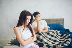 The girl is offended by the guy. Family quarrel.  Stock Photos