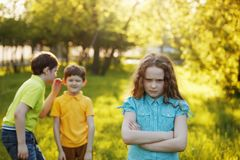 girl offended after quarrel to his brothers. Royalty Free Stock Images