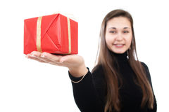Girl offer the present Royalty Free Stock Image