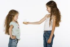 Girl offering bithday cake Stock Photo