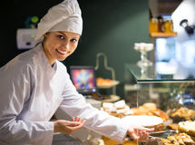 Girl offering bread and different pastry for sale Stock Photography
