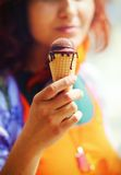 Girl offering a chocolate ice cream on an early summer day, Ice Royalty Free Stock Photography