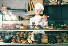 Girl offering desserts in the pastry shop Stock Image