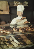 Girl offering desserts in the pastry shop Royalty Free Stock Photo