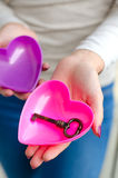Girl offering key to her heart Stock Photo