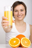 Girl offering orange juice Royalty Free Stock Images