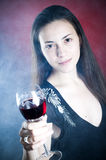 Girl offering wine Stock Photo