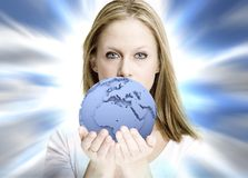 Girl offering the world stock photo