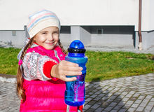 Girl Offers A Water Bottle Stock Photos