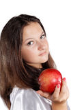 Girl offers an apple isolated Stock Photos
