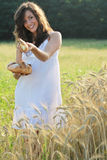 Girl offers a piece of bread Royalty Free Stock Photo