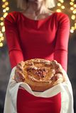 A girl offers ritual bread. Christmas concept Stock Photography