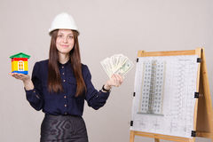 Girl offers to invest in construction of houses Stock Photo