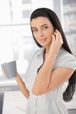 Girl in office with coffee Stock Images