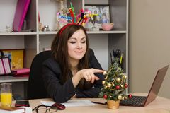 Girl in the office, decorated for new year Royalty Free Stock Images