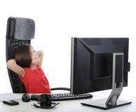 Girl in the office in front of computer Stock Photos