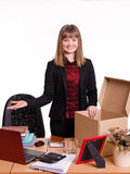 Girl in the office gets a new workplace Stock Images