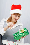 Girl in the office with a New Year gift Royalty Free Stock Photos