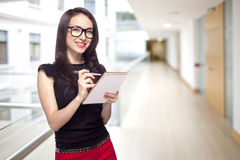Girl in office with paper notepad Royalty Free Stock Images
