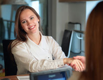girl in the office smiling Royalty Free Stock Image