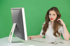 Girl in office stopped to think Stock Images