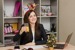 Girl in the office to celebrate New Year Stock Photo