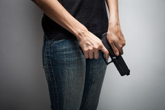 Girl Officer Concealing Weapon Stock Image
