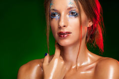 Girl with oily skin and creative make up. On dark green make up in studio photo Royalty Free Stock Image