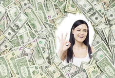 Girl with ok sign in a dollar frame Stock Photography