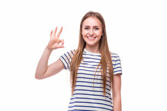 Girl with okey gesture. On white Royalty Free Stock Photo