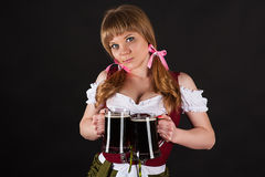 Girl Oktoberfest with beer in hand Royalty Free Stock Photography