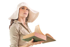 Girl with old book Stock Photos