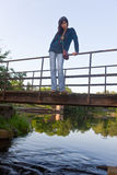 The girl on the old bridge Royalty Free Stock Photography