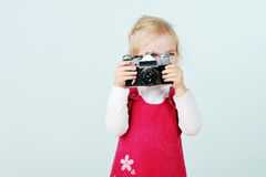 Girl  with old  camera Stock Photography