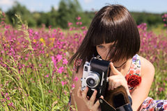 Girl  with old camera. Stock Photo