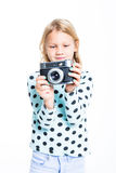 Girl with an old camera Stock Image
