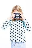 Girl with an old camera Stock Photography