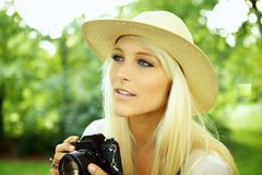 Girl with old camera scouting Stock Image